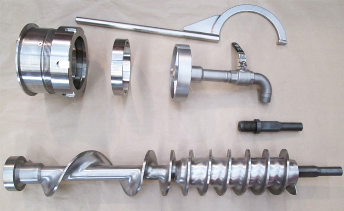 Guelt Techni-Services - Machined screw and parts of a grinder