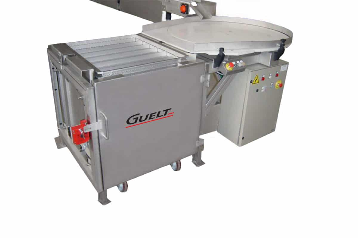 Manual retort rack loader coupled to a rotative accumulation table - Guelt