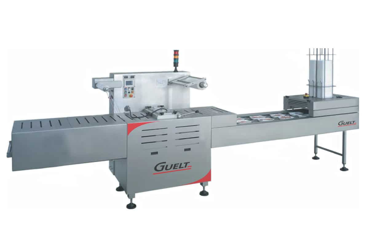 Automatic tray sealer OPA2005 coupled with a tray unstacker - Guelt